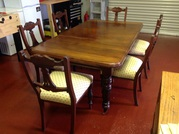 Victorian mahogany dining table plus 6 chairs.